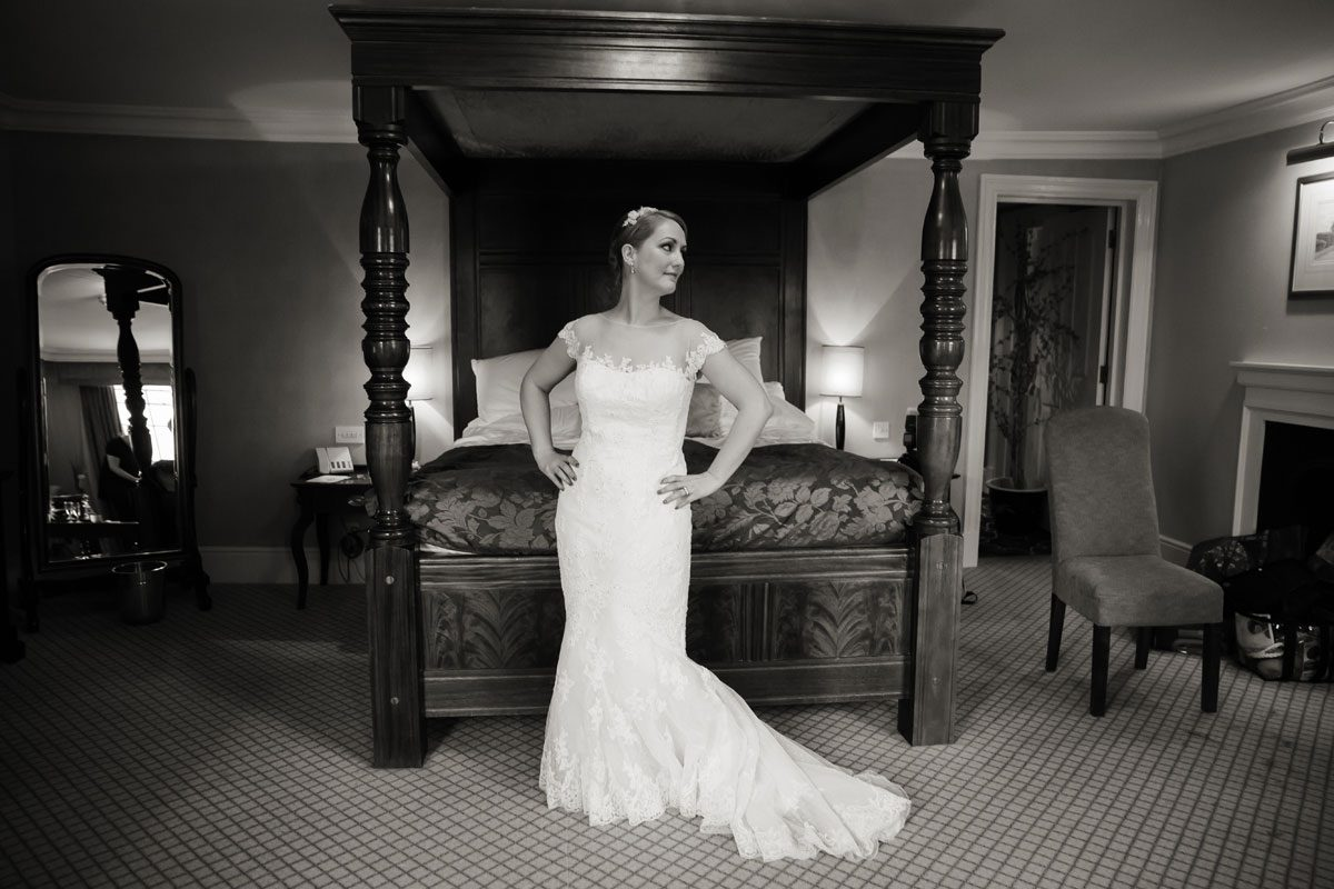 Bride in front of four poster bed Hampton Court wedding shot