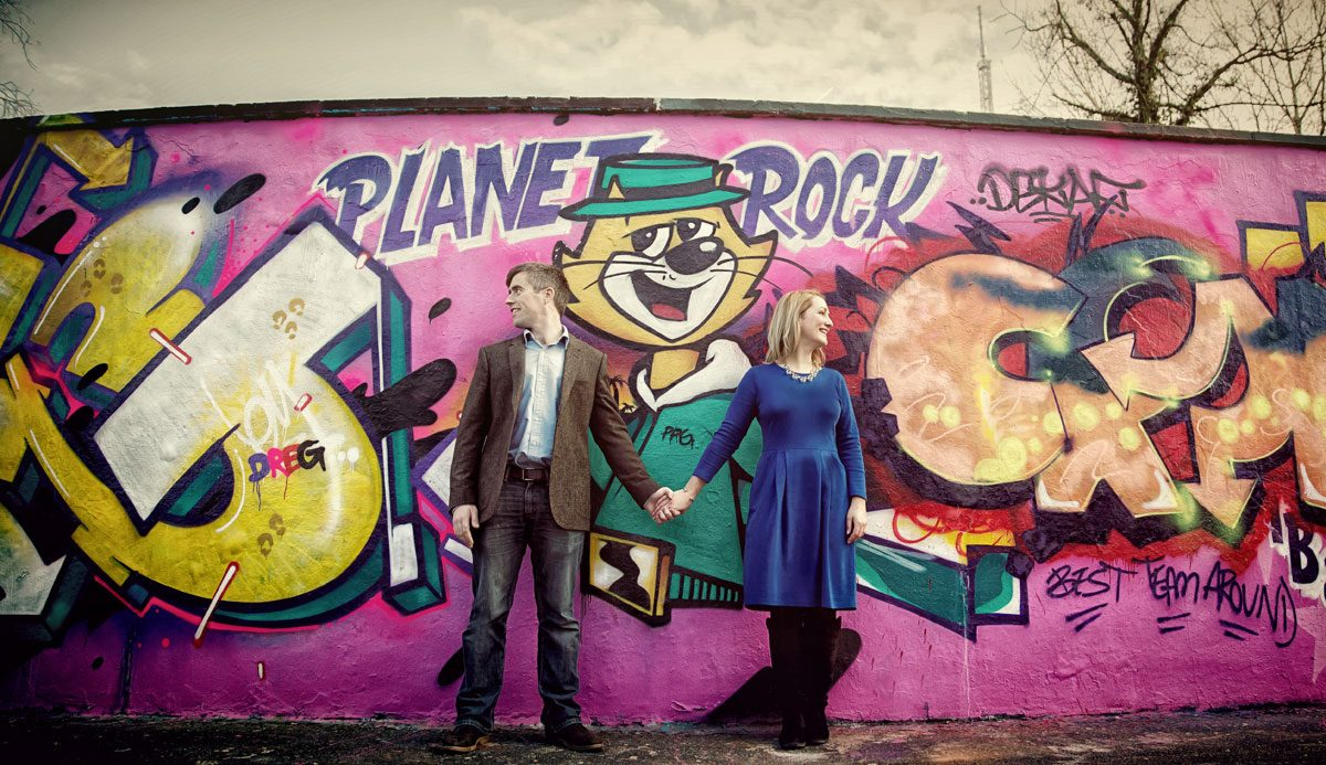 Engagement shoot couple stand by Alexandra Palace grafitti wall