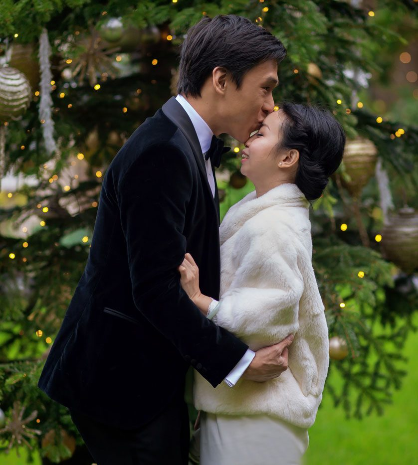 Kissing by the Christmas tree at Goring Hotel