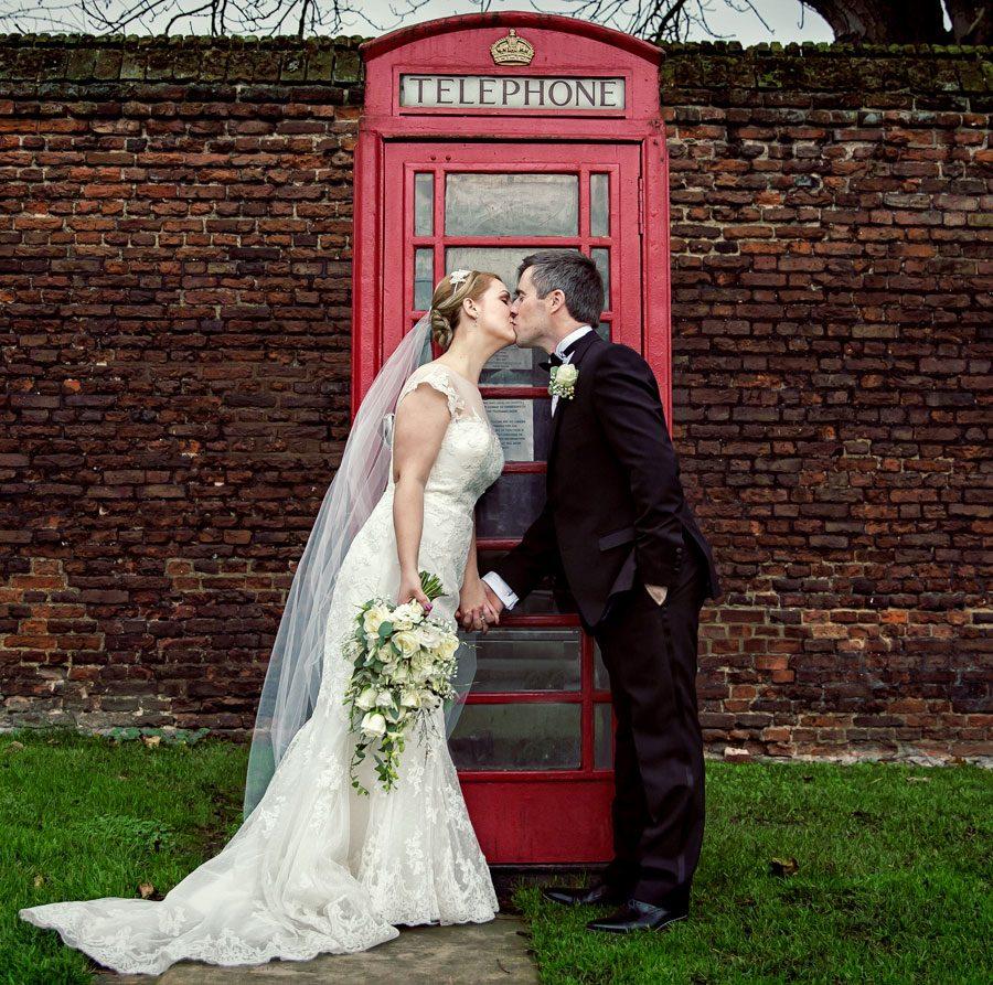 Phone box kissing shot outside Hampton Court Palace