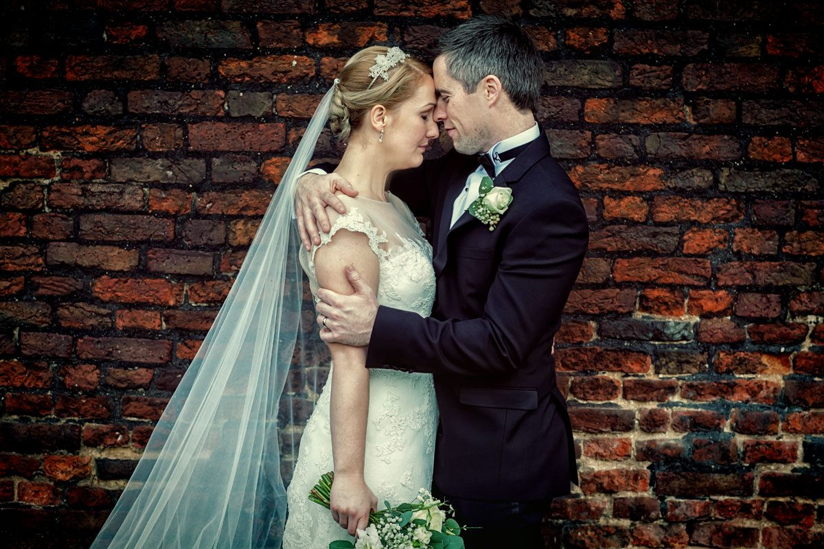 Wedding couple by London Hampton wall