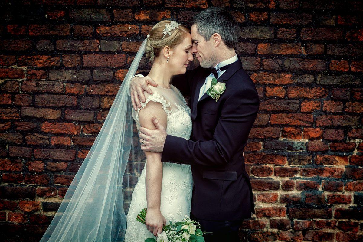 Wedding couple by London Hampton wall
