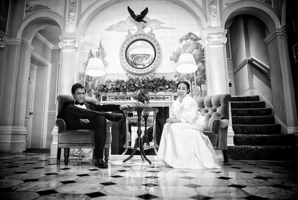Wedding photo of couple in lobby of Goring Hotel London