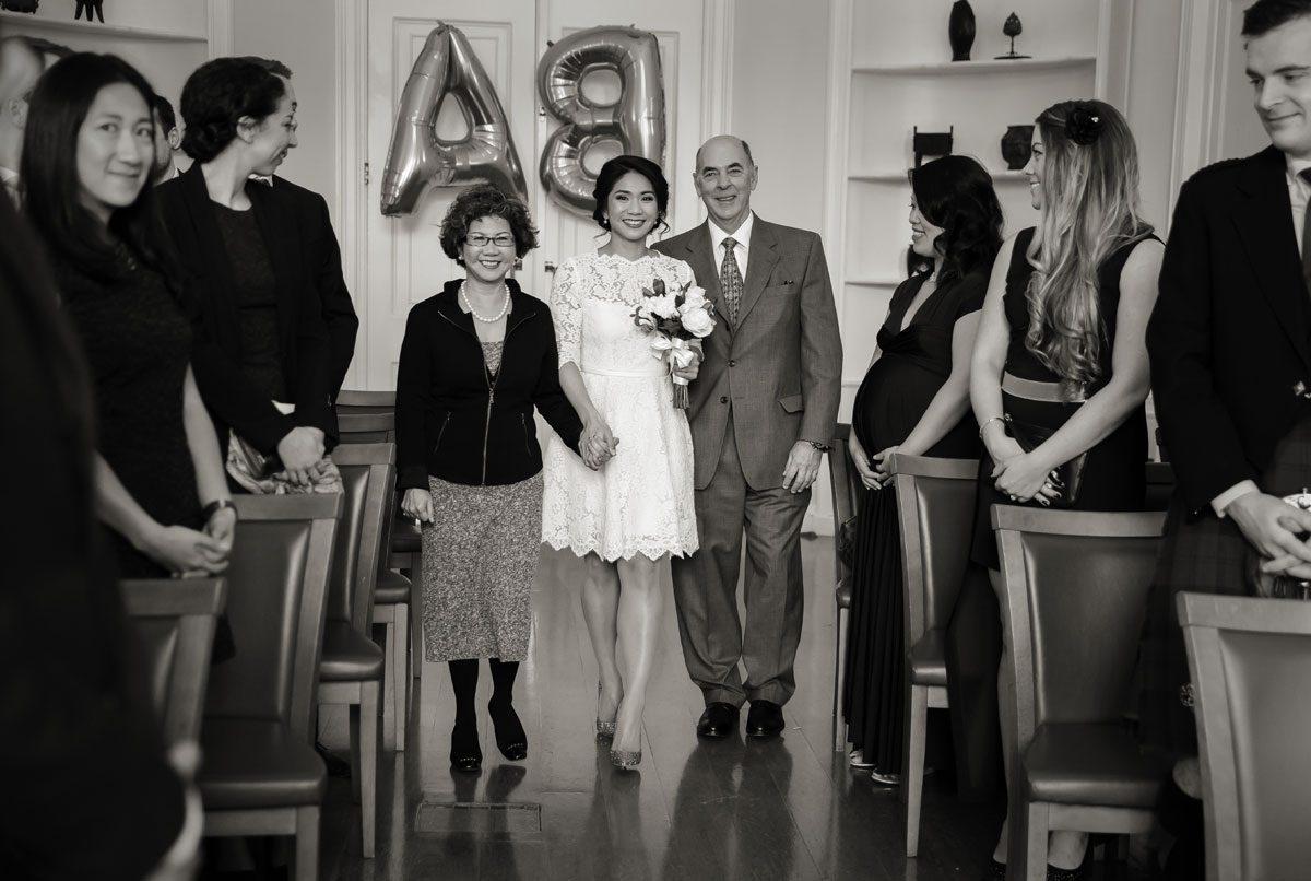 Bride walks down the aisle at Asia House wedding