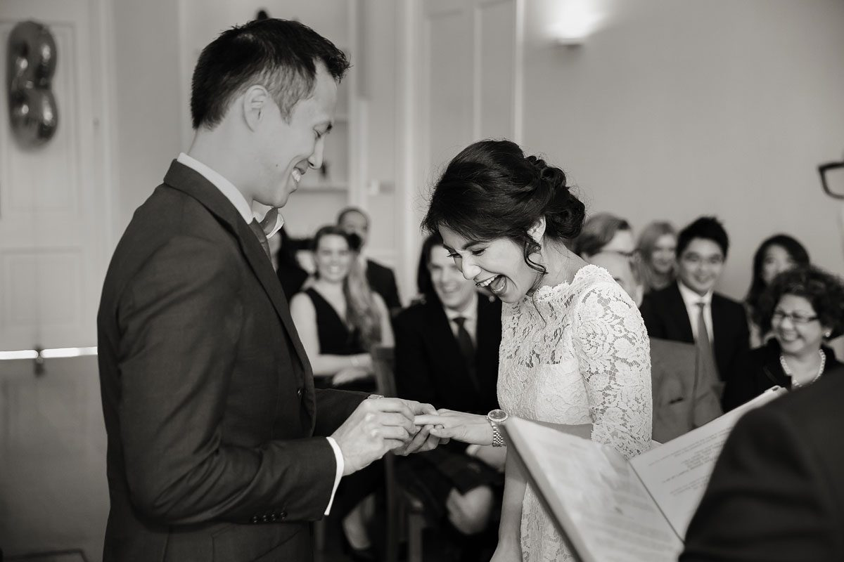 London wedding couple exchanging rings at Asia House photo