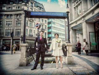 Oxford Circus wedding day couple holding hands photo