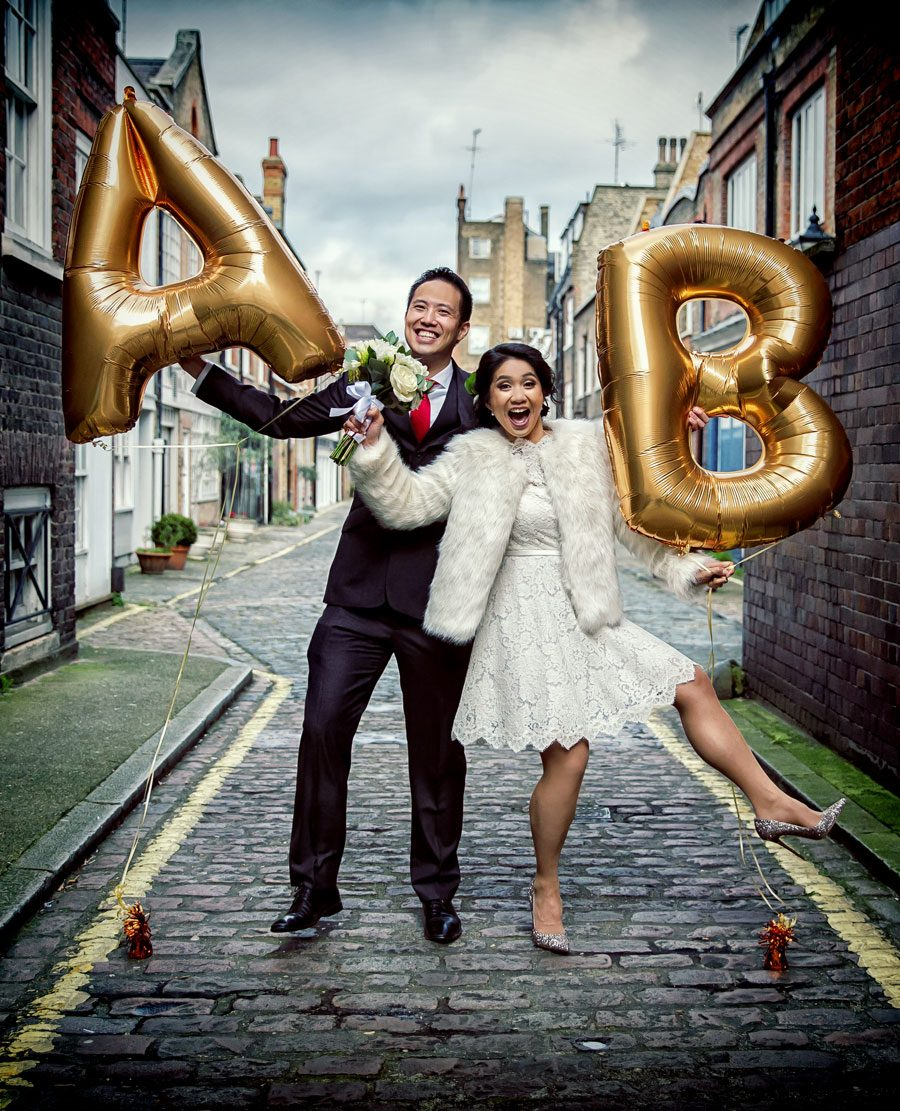 couple with balloons on their central London wedding day
