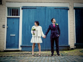 wedding couple hold hands in central London mews image