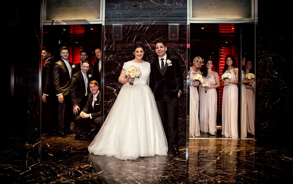 Bridal party pose in lifts Jewish wedding Four Seasons Park Lane London