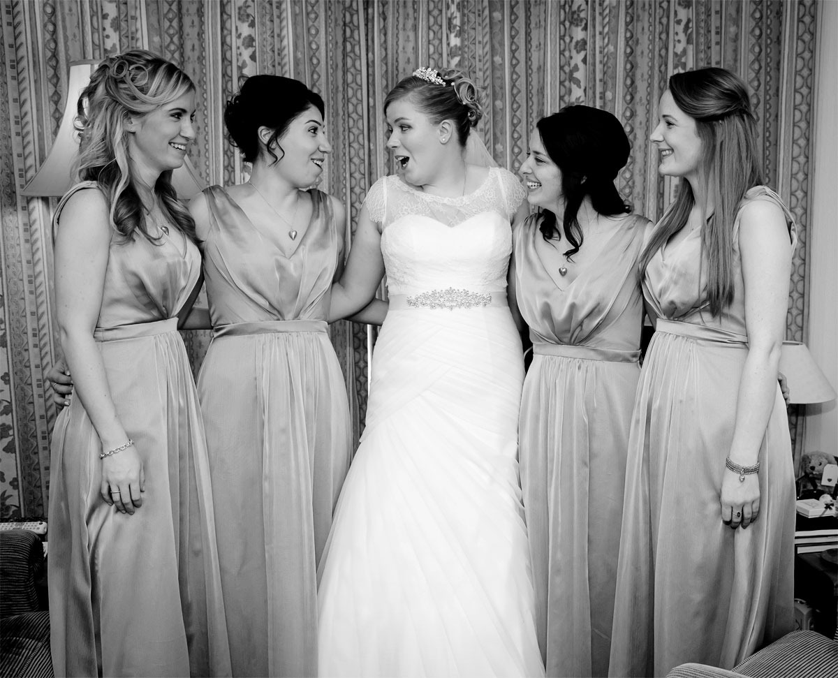 Bride and bridesmaids laugh at London wedding