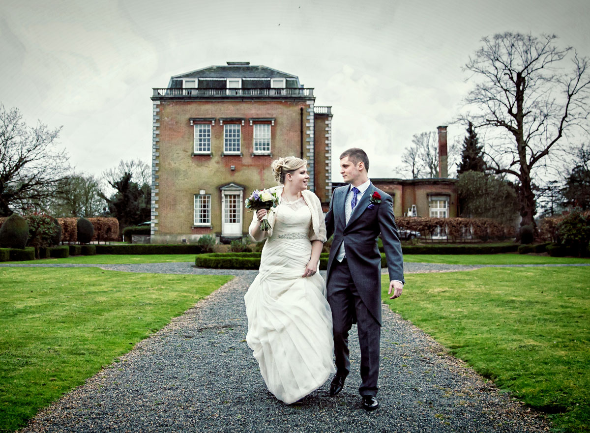Bride and groom walkng at theobalds Park wedding