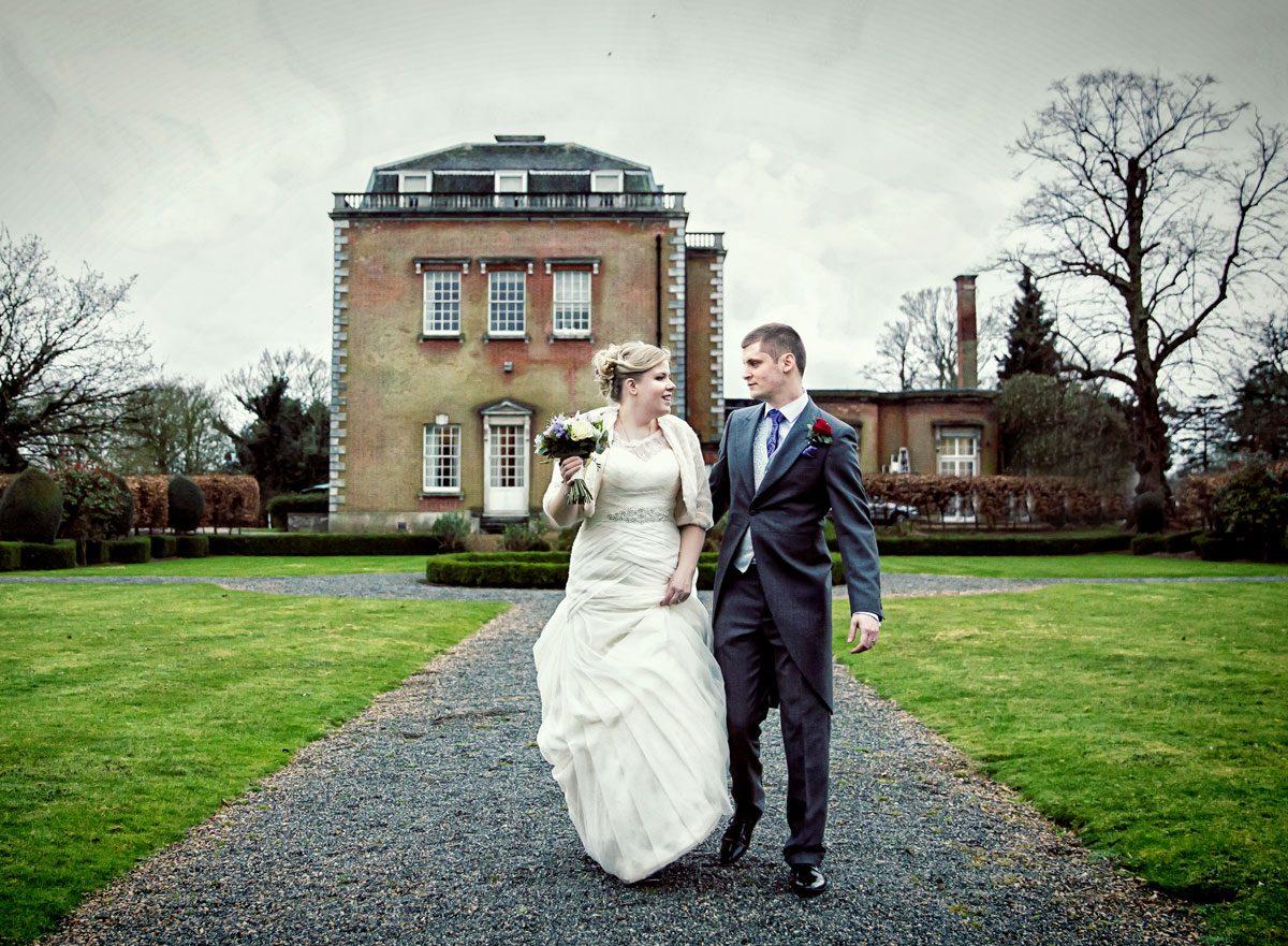 Bride and groom walkng at theobalds Park wedding