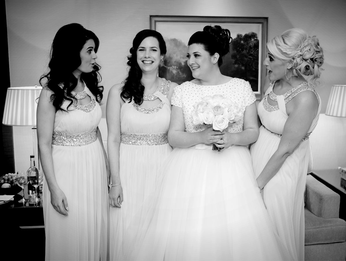 Bridesmaids laughing at Four Seasons Hotel wedding photo