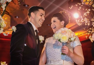 Couple laugh during wedding ceremony at Four Seasons Park Lane