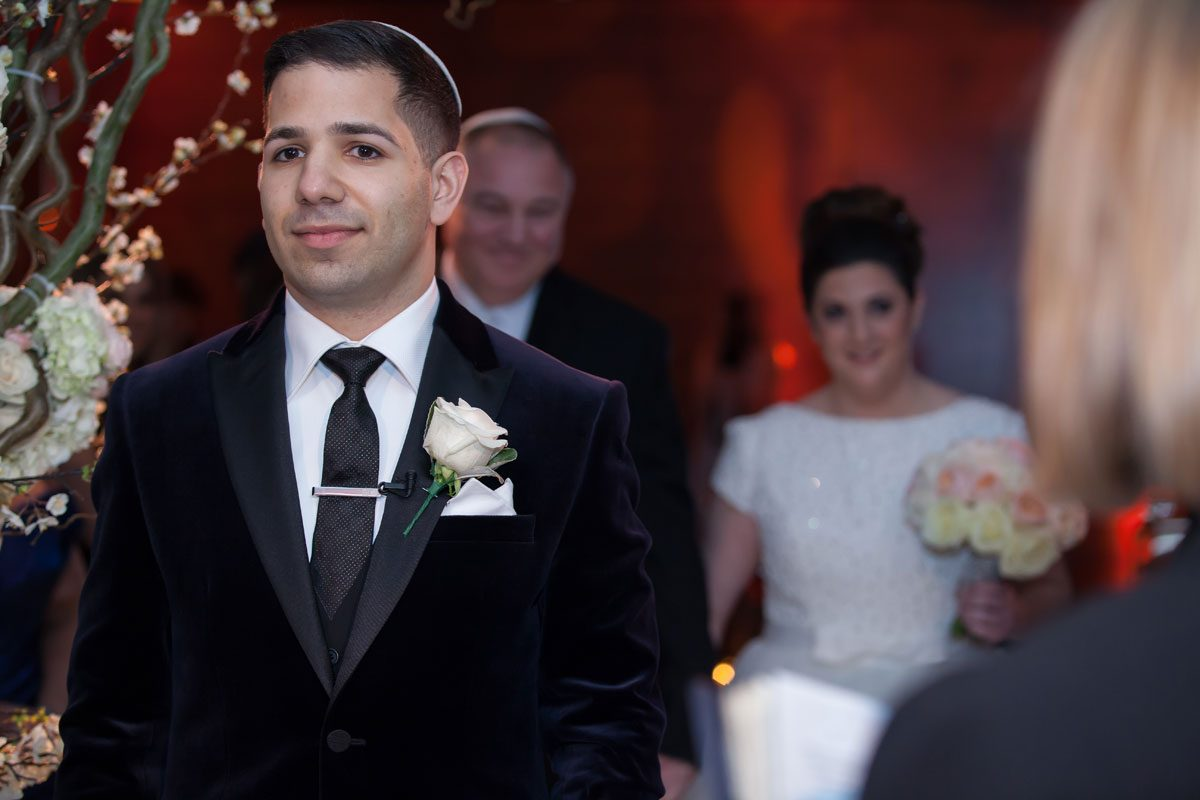 Groom waits as bride arrives Four Seasons Hotel