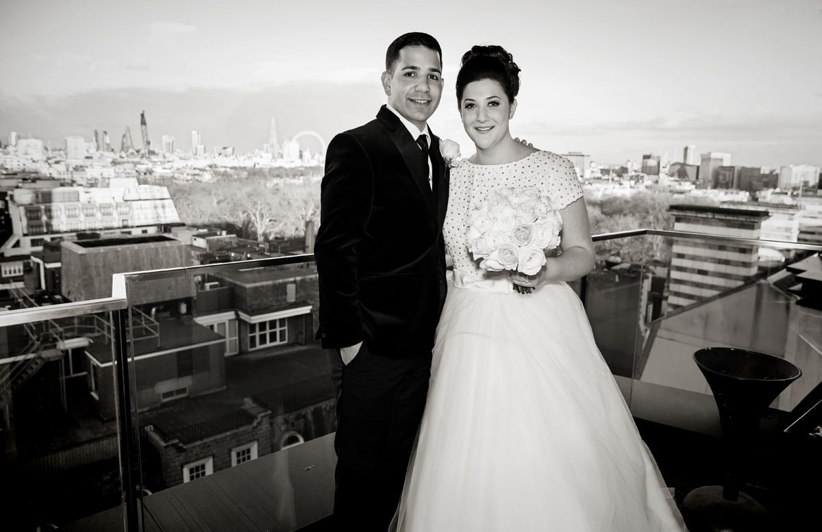 Wedding couple pose on roof Four Seasons Hotel