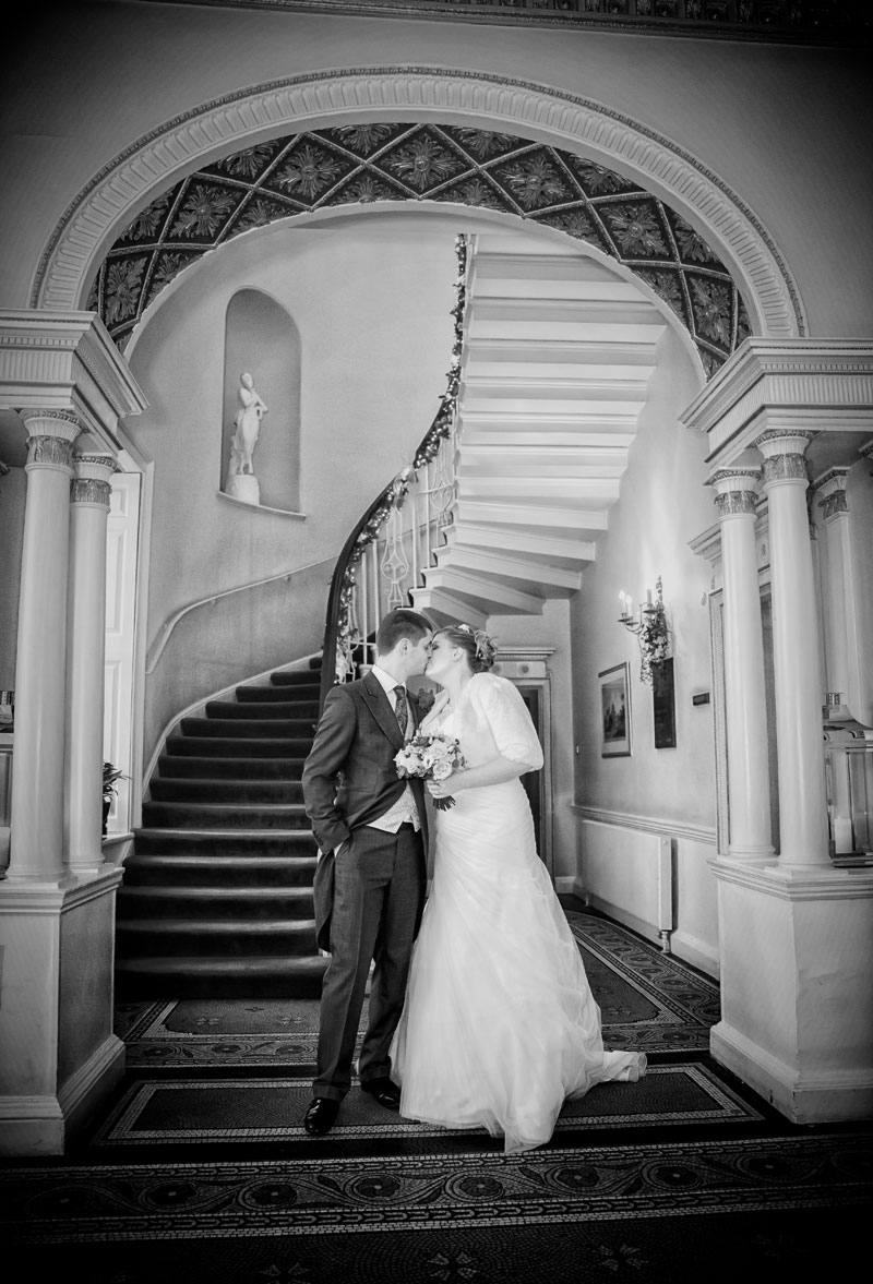 wedding couple kiss in Theobalds Park reception