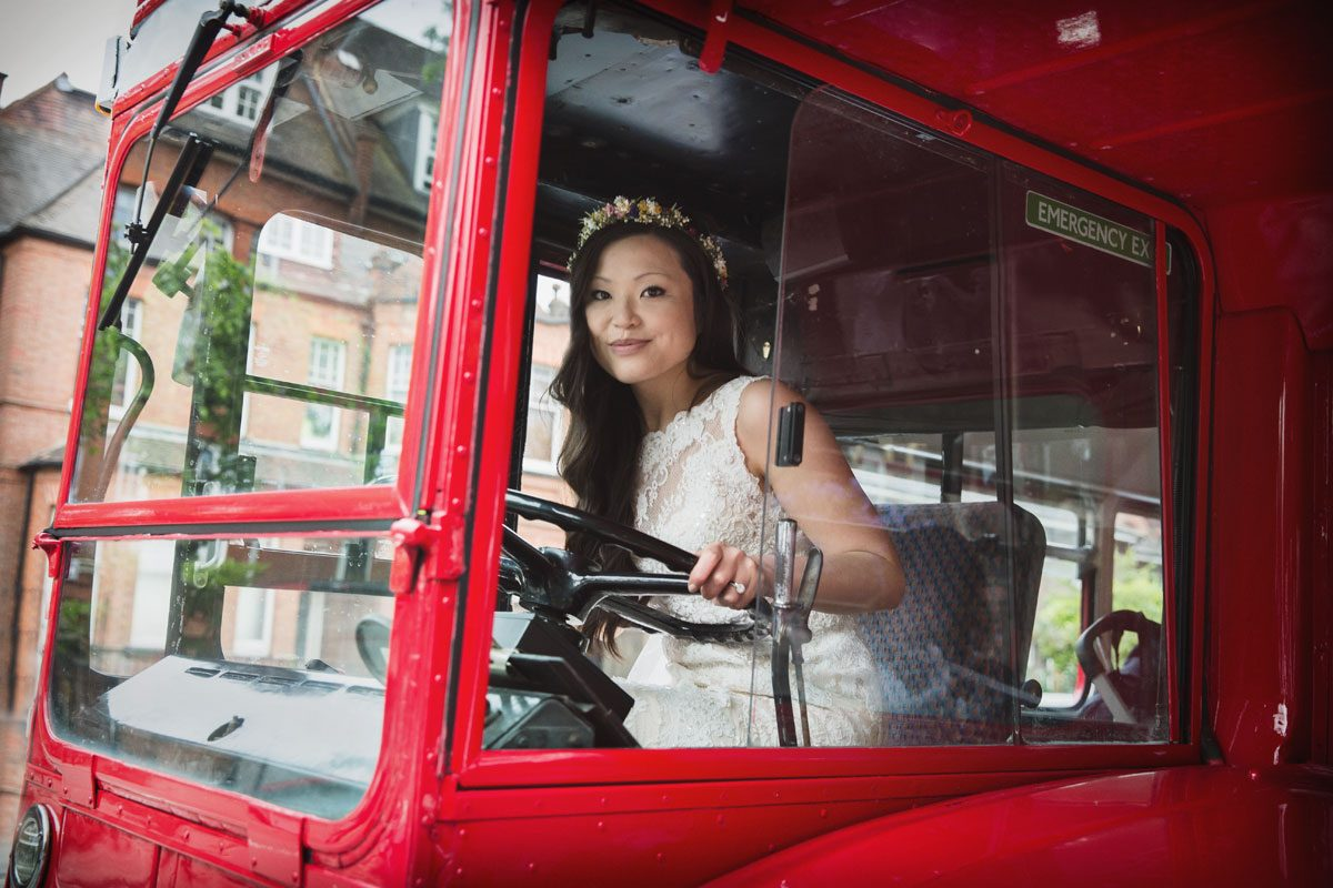 Bride drives route master bus on her London wedding day photo