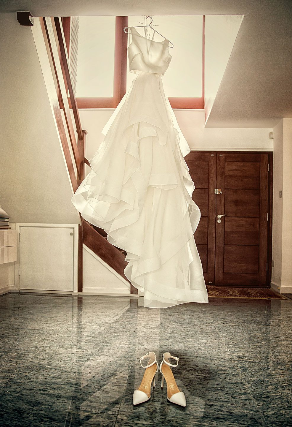 Bride's wedding dress hangs waiting for central London wedding image
