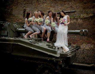Bridesmaids sit on tank at London Islington wedding day image
