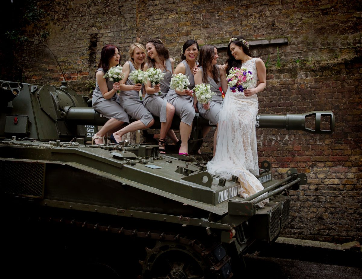 Bridesmaids sit on tank at London Islington wedding day image