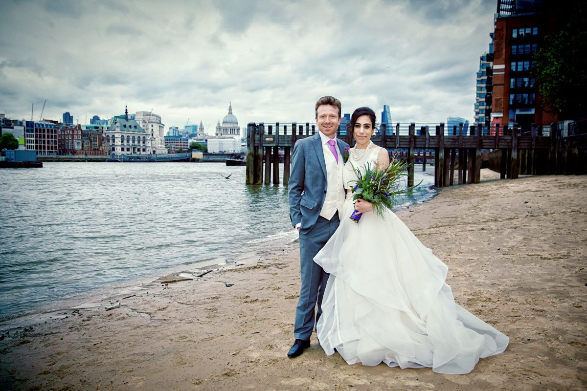 Couple on south bank beach after London Oxo Tower wedding