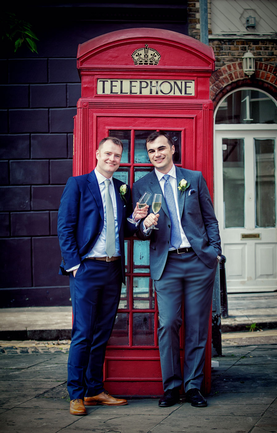 Couple with champagne by Clerkenwell phone box