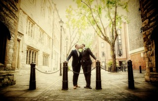 London gay wedding photographers kissing couple photo