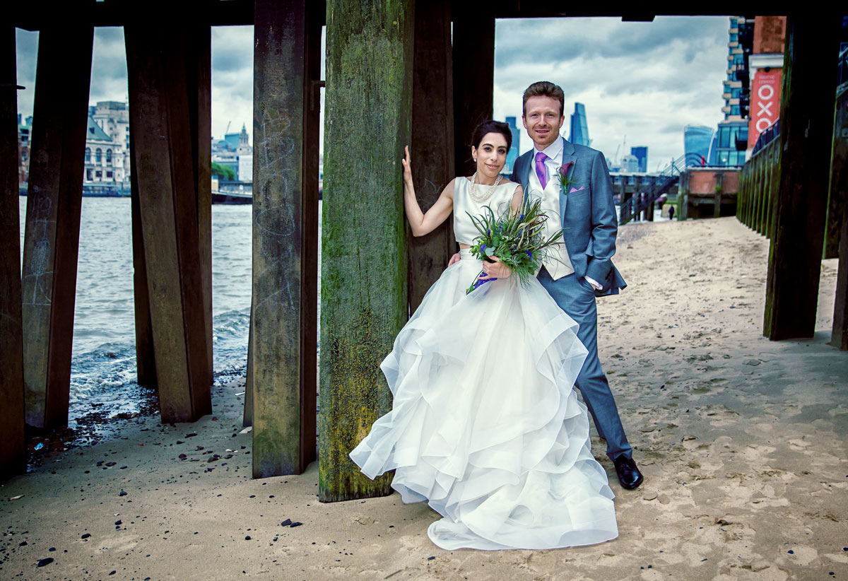 Wedding couple on the beach Oxo Tower London crop