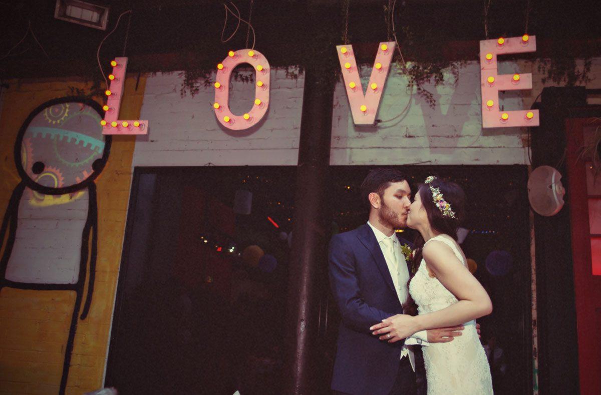 new man and wife kiss at Islington Metal works wedding