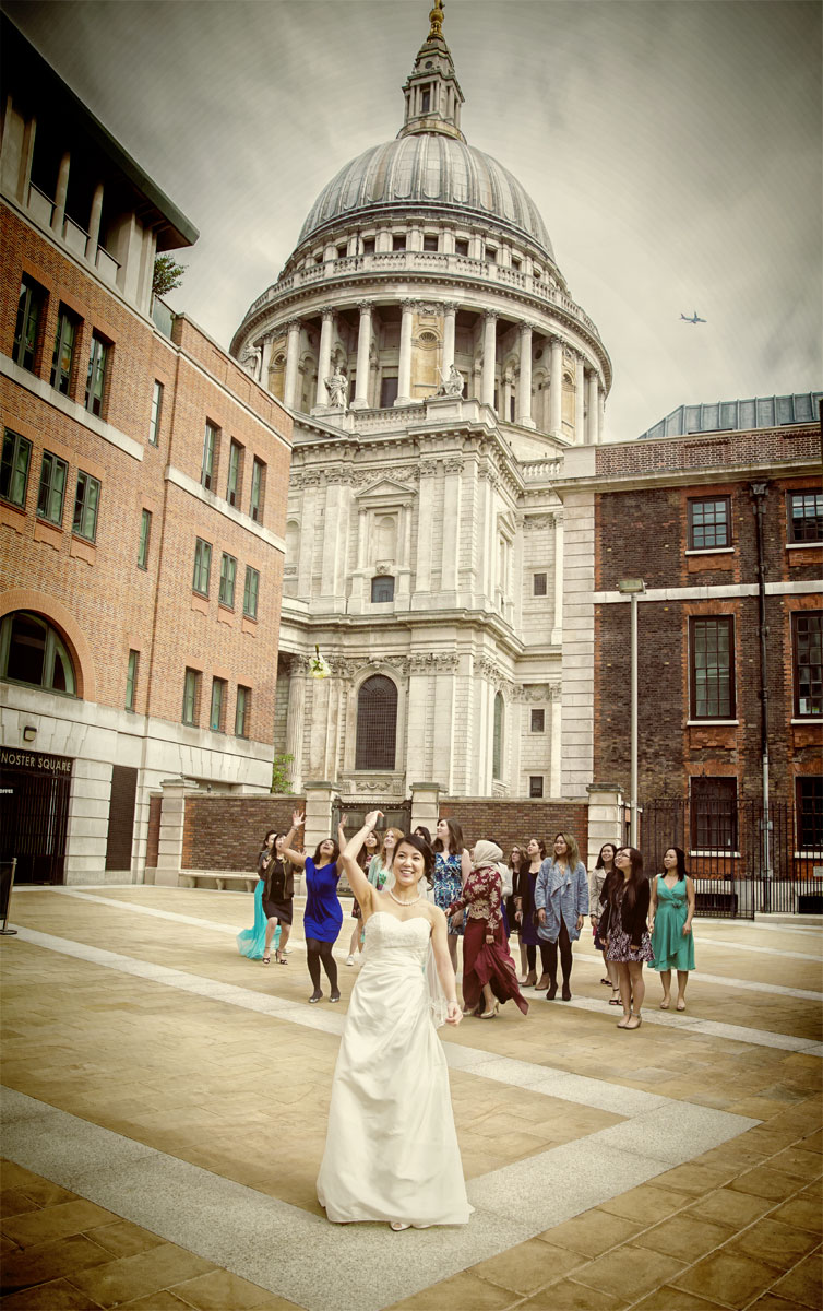 Bridal bouquet toss in front of St Pauls cathedral London image
