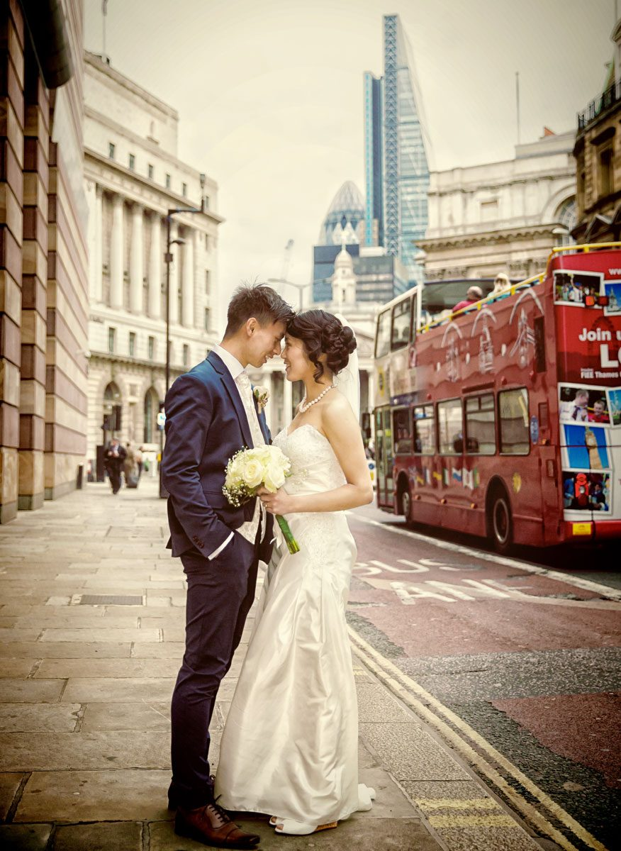 Husband and wife near Bank Station on London wedding day
