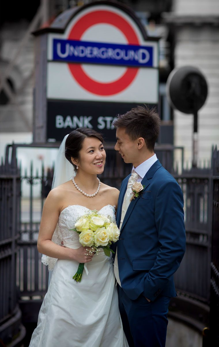 Wedding couple stand by Bank Station