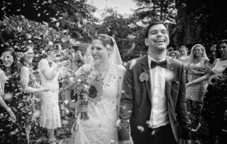 wedding couple in confetti at Eltham Tudor Barn London