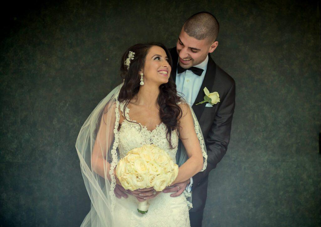 Bride and groom having fun at Jumeriah Carlton Hotel Wedding
