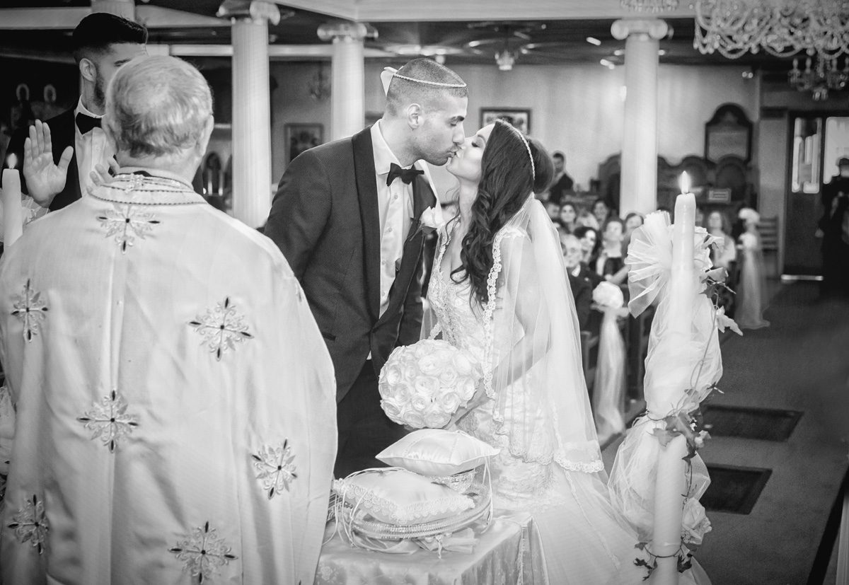 First kiss Greek wedding ceremony London image