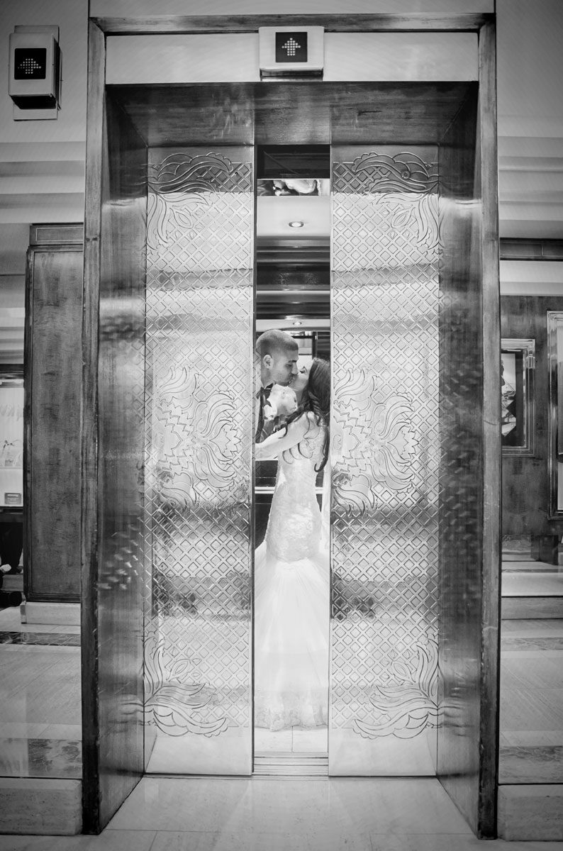 wedding couple kiss in the lift at Jumeriah Carlton Hotel London