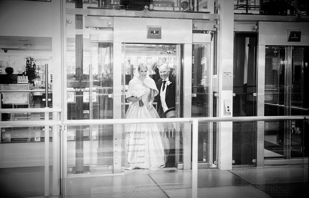 Bride and father in lift on St Pauls wedding day image