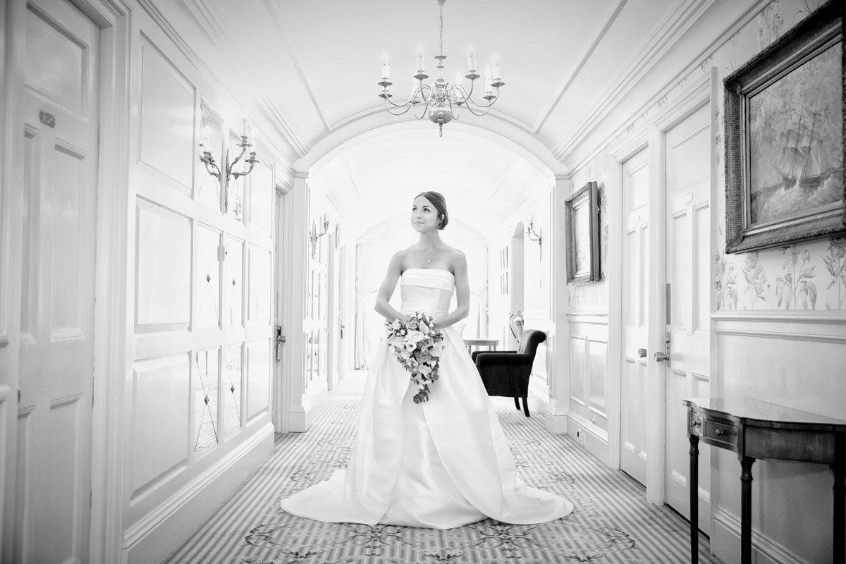 Bride waits in hallway at London Goring Hotel wedding