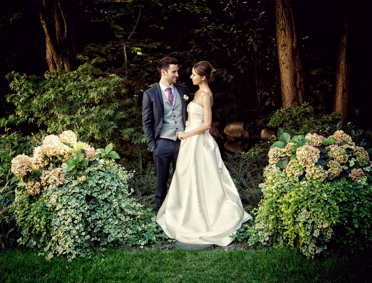 Goring Hotel Wedding Photographers couple in garden image