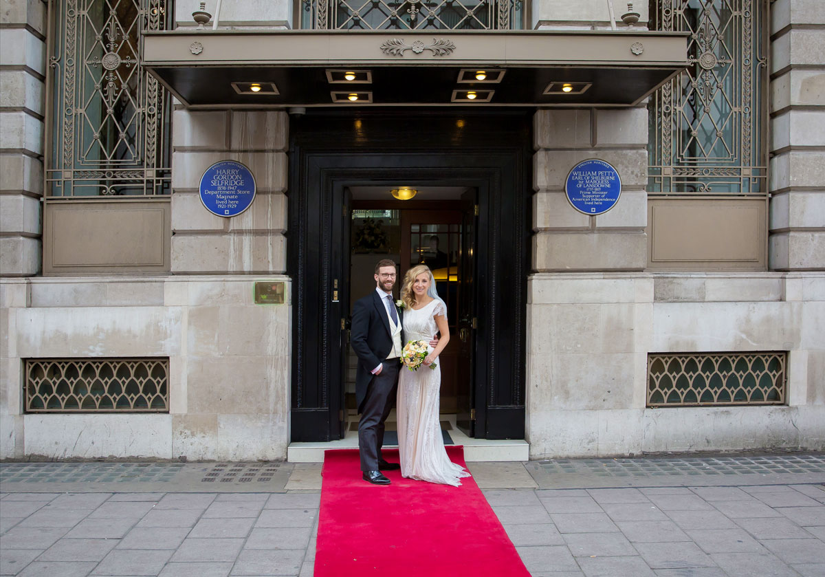 Lansdowne Club wedding couple pose outside entrance