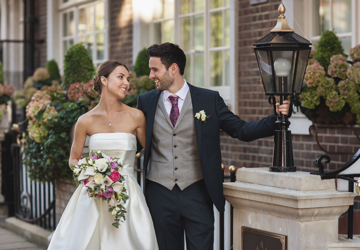 Laughing outside the Goring Hotel on their wedding day image