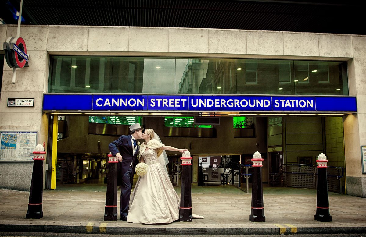 London wedding couple kiss by tube station