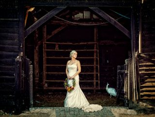south farm weddings bride in barn photo