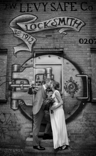 wedding couple by grafitti at east London wedding dat