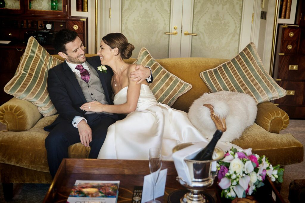 wedding couple hug in Royal Suite at The Goring Hotel