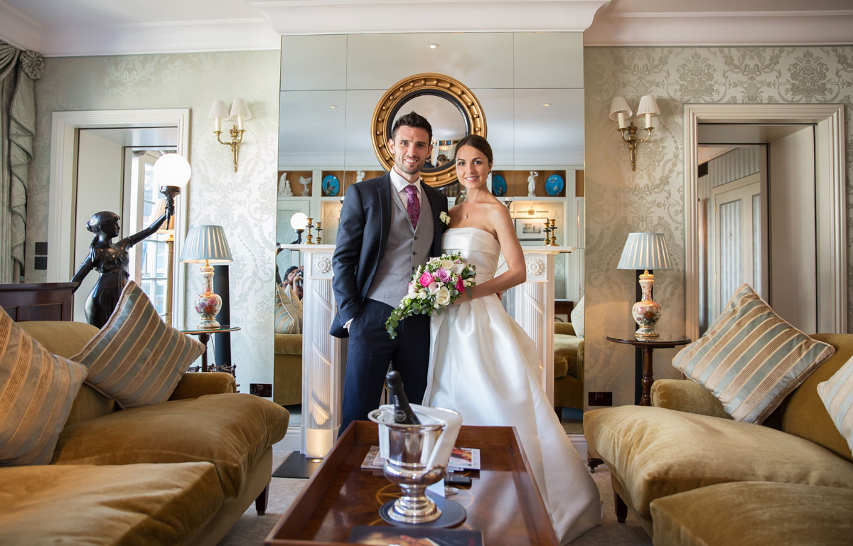 Wedding couple pose in the Royal Suite at Goring Hotel wedding
