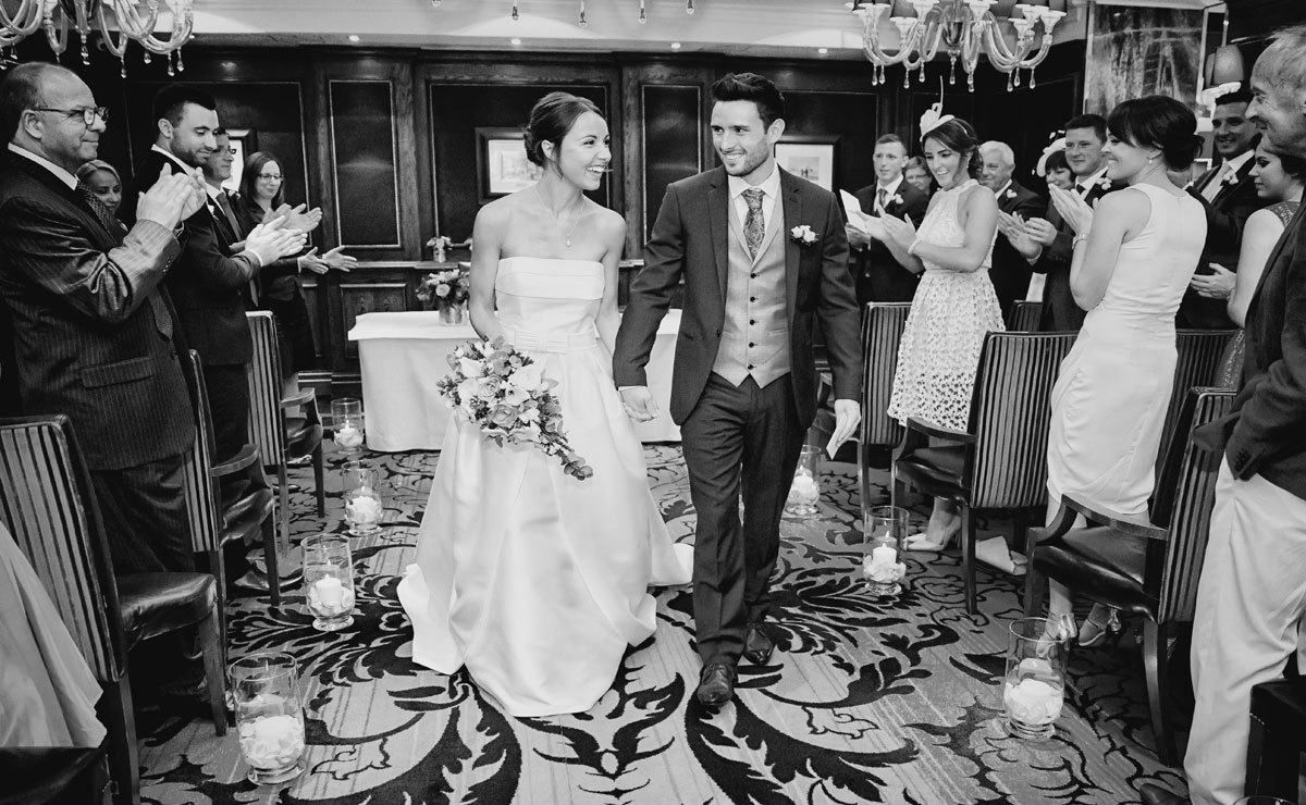 Wedding recessional photo from Goring Hotel wedding photographers