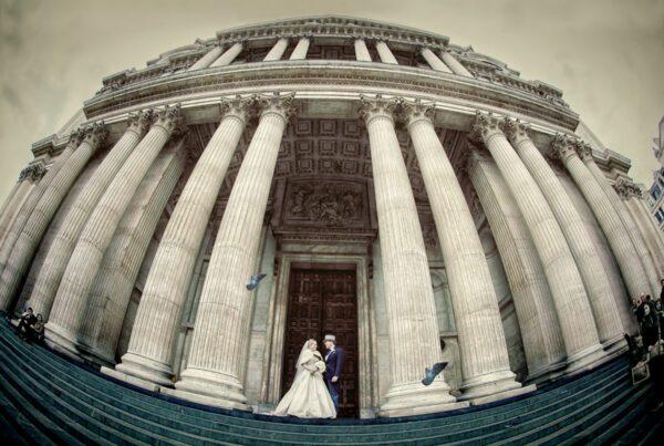 St Pauls Cathedral wedding photographer couple pose outside photo
