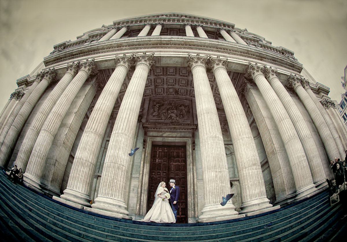 St Pauls Cathedral wedding photographer couple pose outside photo